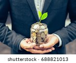 businessman cover growing plant ... | Shutterstock . vector #688821013