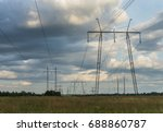 power lines in the field | Shutterstock . vector #688860787
