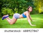 beautiful sporty woman doing...   Shutterstock . vector #688927867