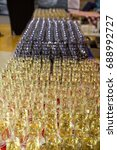 a lot of glasses with alcohol ... | Shutterstock . vector #688992727