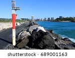 Small photo of The rock wall at Letitia Spit in northern NSW Australia