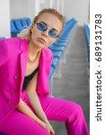 beautiful young woman sitting... | Shutterstock . vector #689131783