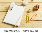 open notepad on wooden... | Shutterstock . vector #689146243