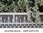 White Metal Fence With Unusual...