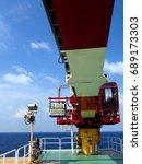 Small photo of Crane operation, Crane boom, Crane cabin room at offshore wellhead platform.