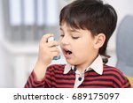 boy using inhaler during... | Shutterstock . vector #689175097