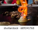 Small photo of Chef mad for us hibachi onion volcano in Japanese restaurant