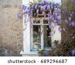 windows of old mansion framed... | Shutterstock . vector #689296687