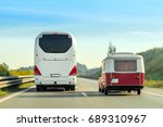 camper and bus on the road in...