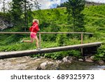 girl trail running in mountains ... | Shutterstock . vector #689325973