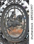Small photo of Metal grille in the form of medieval horseman closeup in the Kazimierz, Jewish quarter of Krakow, Poland. Pauline Church on the Rock fence.