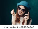 woman in a happy hat holds a... | Shutterstock . vector #689336263
