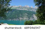 Small photo of The mountain chain Churfirsten in Switzerland and a part of the Lake Walensee, steep rocks and turquoise-coloured water/The mountain chain Churfirsten