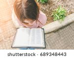 woman reading bible on the... | Shutterstock . vector #689348443
