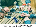 friends using phones on the... | Shutterstock . vector #689397463