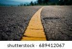 asphalt highway with yellow... | Shutterstock . vector #689412067