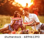 young couple  sitting on grass... | Shutterstock . vector #689461393