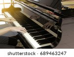 Small photo of Close up of hand play grand piano.