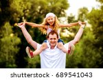 dad and daughter playing... | Shutterstock . vector #689541043