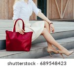 part of body. girl sitting on... | Shutterstock . vector #689548423