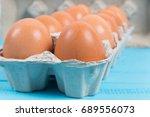 raw chicken eggs in a box | Shutterstock . vector #689556073
