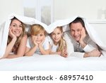 parents and children laying in... | Shutterstock . vector #68957410