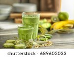 fresh tasty smoothies in... | Shutterstock . vector #689602033