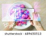 woman holding a smart device... | Shutterstock . vector #689650513