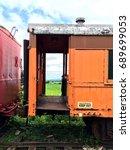 train boxcar on overgrown tracks   Shutterstock . vector #689699053