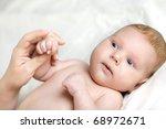 little newborn baby lying on... | Shutterstock . vector #68972671