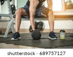 bodybuilder working out with... | Shutterstock . vector #689757127