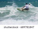 july 29  unidentified surfer in ...   Shutterstock . vector #689781847