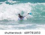 july 29  unidentified surfer in ...   Shutterstock . vector #689781853