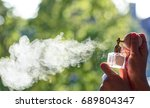 females hand is spraying... | Shutterstock . vector #689804347