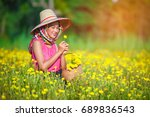 beautiful girl collects flowers ... | Shutterstock . vector #689836543