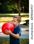 little boy inflate big red ... | Shutterstock . vector #689836957