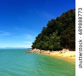 Small photo of Summer day on the beach in Abel Tasman National Park