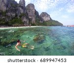 a young man is snorkeling and...   Shutterstock . vector #689947453