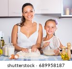 cheerful housewife and girl... | Shutterstock . vector #689958187