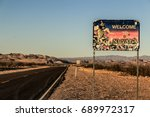 Small photo of NEVADA STATE LINE, DEATH VALLEY, CALIFORNIA, USA - AUGUST 2017 : Nevada state line sign along the Daylight Pass Road to Beatty (Nevada) at Sunset on summer.