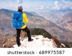 woman with backpack hiking in... | Shutterstock . vector #689975587