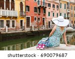 girl sitting on a pier near the ... | Shutterstock . vector #690079687