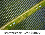 aerial solar photovoltaic | Shutterstock . vector #690088897