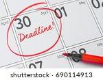deadline written on a calendar  ... | Shutterstock . vector #690114913