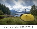 yellow camping tent on... | Shutterstock . vector #690132817