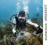 marine biologist studying black ... | Shutterstock . vector #690245377