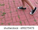 male legs walking on a bright...   Shutterstock . vector #690275473