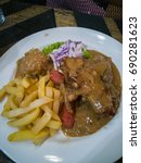 asian chicken chop with fries... | Shutterstock . vector #690281623