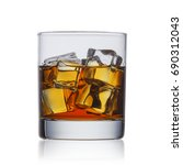 whiskey with ice in a glass on... | Shutterstock . vector #690312043