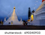 Small photo of Doi Kong Moo pagoda lighting at twilight time in Mae Hong Sorn province, north of Thailand / Doi Kong Moo pagoda / Mae Hong Sorn, Thailand - January 4, 2017 : Doi Kong Moo pagoda at twilight time